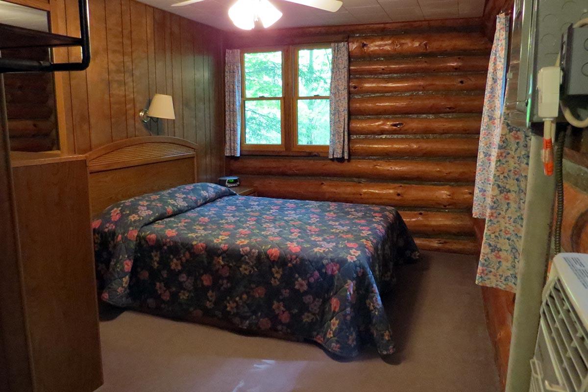 Hillside Log Cabin #6 Bedroom with Queen size bed.